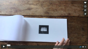book and hand turning pages