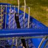 A detail of a blue shopping cart.