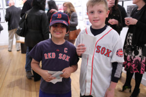 Two young boys in Red Sox uniforms