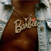 Man's torso with Barbie medallion on
