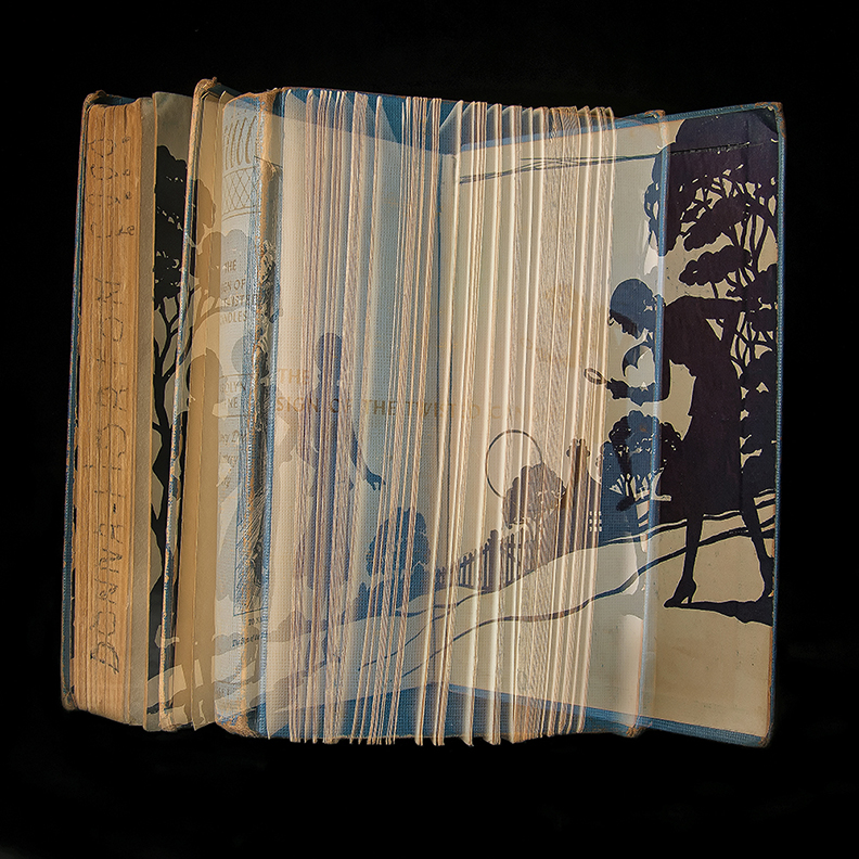 Book with image projected on it
