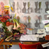 Artist studio with flowers, color strips, sketches, desk and chair