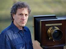 Portrait of a man next to a large format camera.