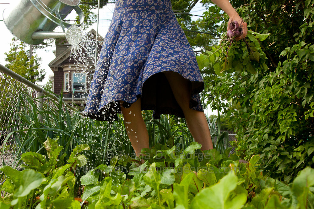Woman picking food in a garden