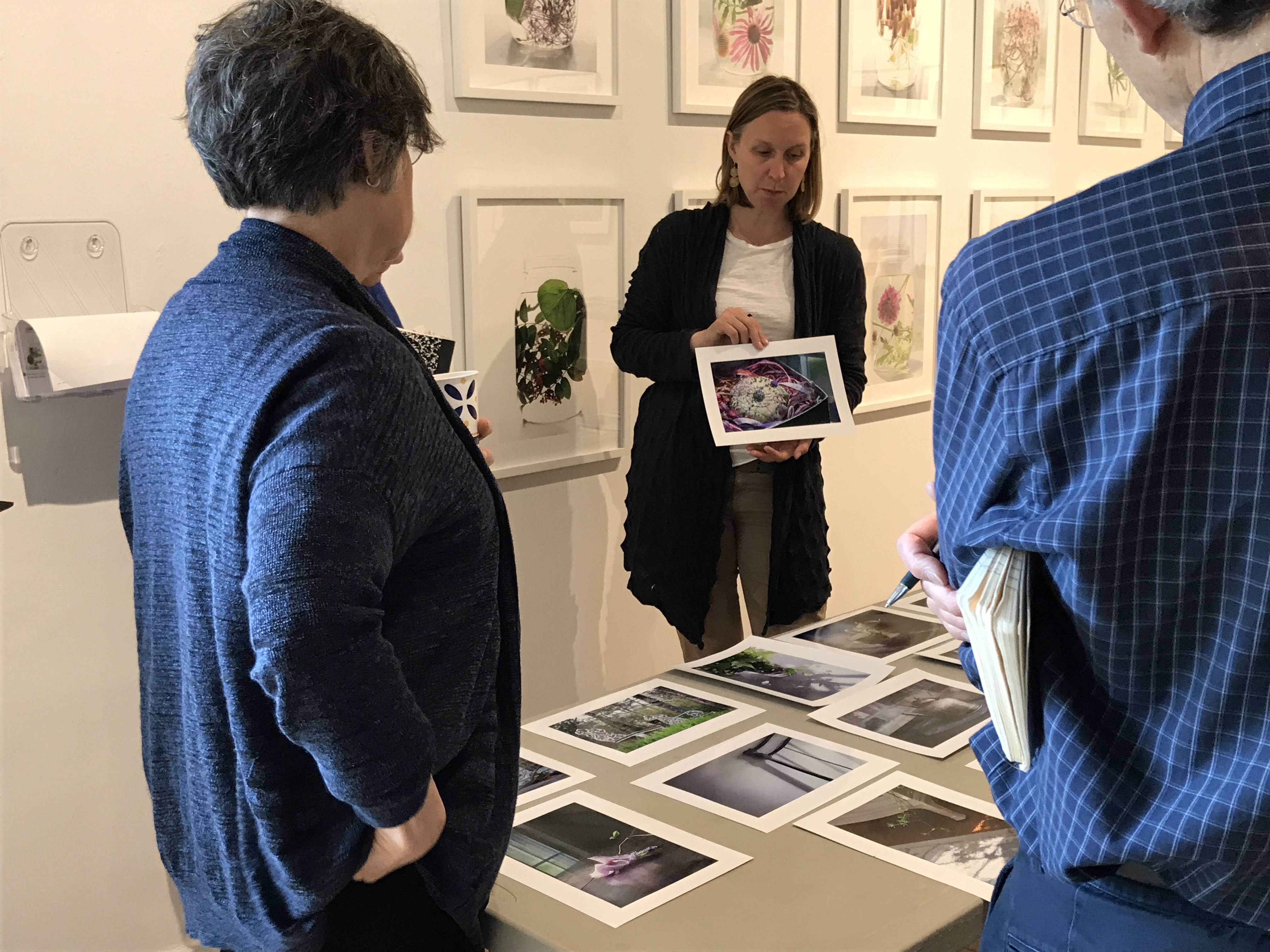Emily Belz holding a photography during a critique