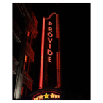 """A red neon sign theatre in Providence missing the last three letter to say """"provide"""" instead."""