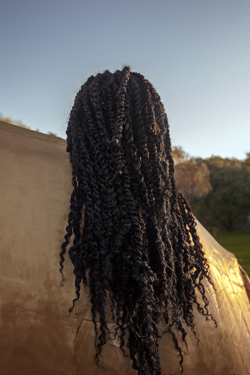 the back of someone's head, a close up of woman's long hair