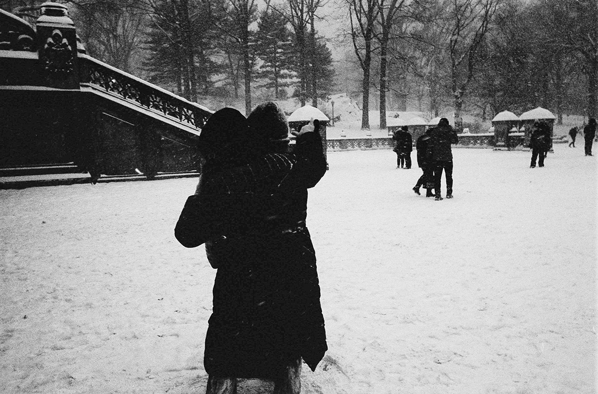 couples dancing across snowy grounds