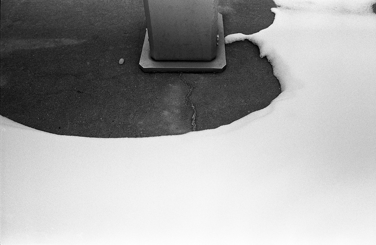 abstract of snow and part of a pole