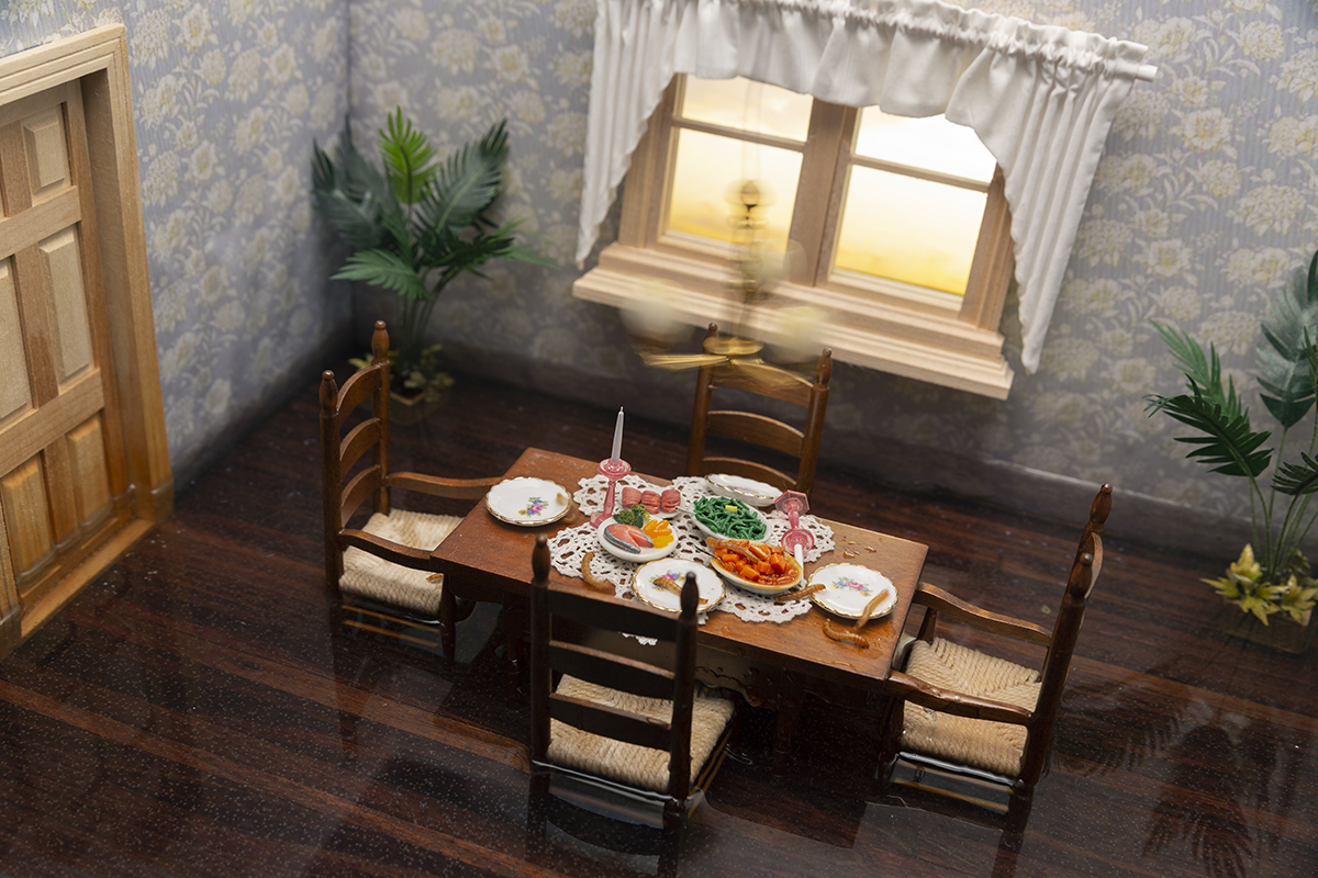 A miniature dining room with a set table