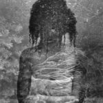 double exposure of a figure of a woman and dirt.