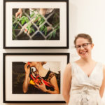 Ivana George standing in front of two framed photographs