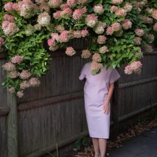 woman under flowered tree