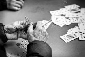 man playing cards - photograph