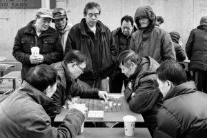men playing checkers chinatown boston photograph