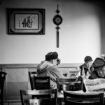 men eating in restaurant chinatown boston photograph