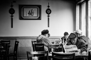 men eating at restaurant chinatown boston photograph