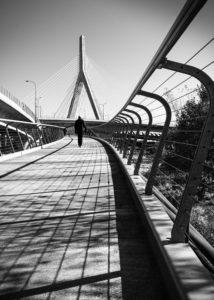 Bridge with man walking - photograph