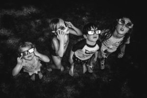 Four Children Looking at a Solar Eclipse