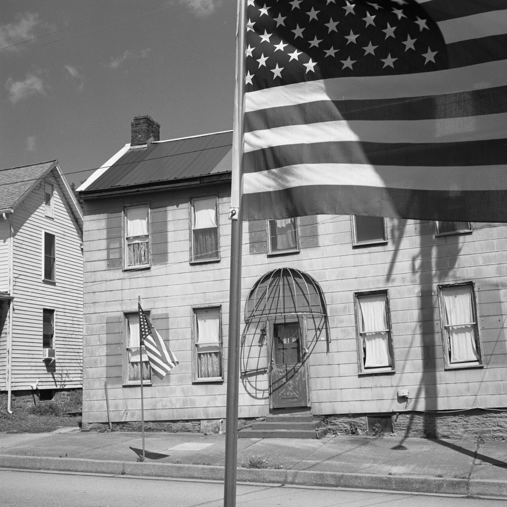 American Flag and Old Building. Bill Franson