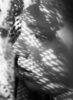 woman by window in sunlight
