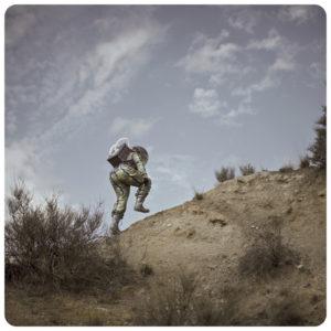 afronaut going up hill