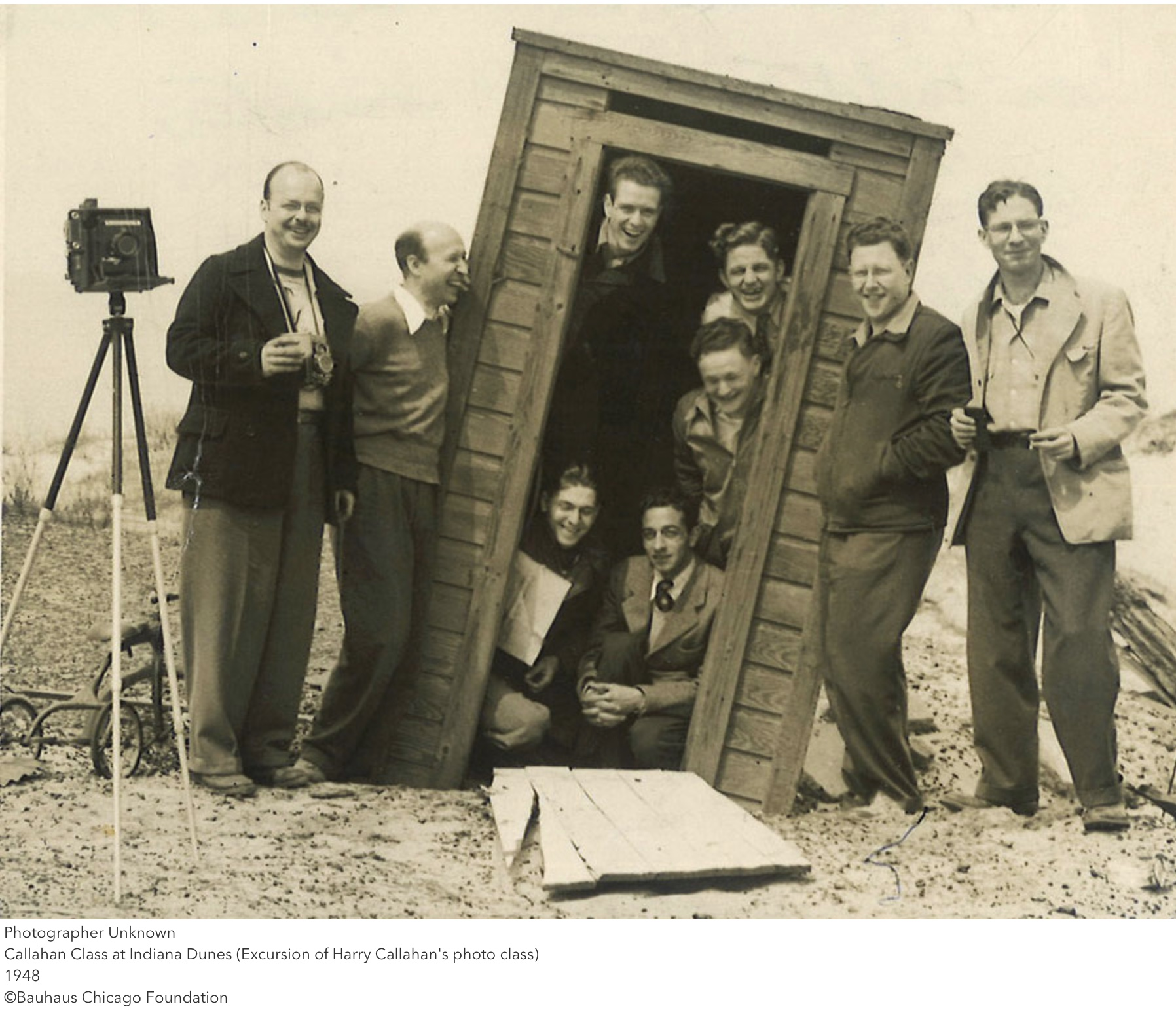 Group of people posing with camera