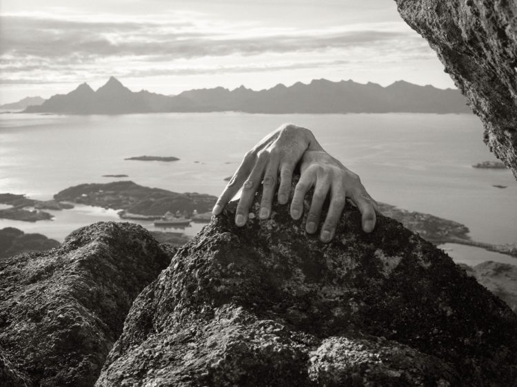 hand on rock