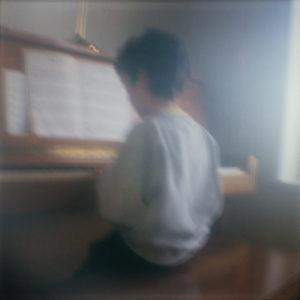 Boy sitting at piano