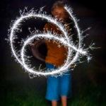 boy swirling sparks