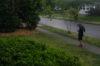 woman on sidewalk by grass