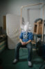masked man in chair