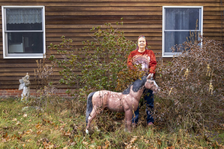 woman with horse statue