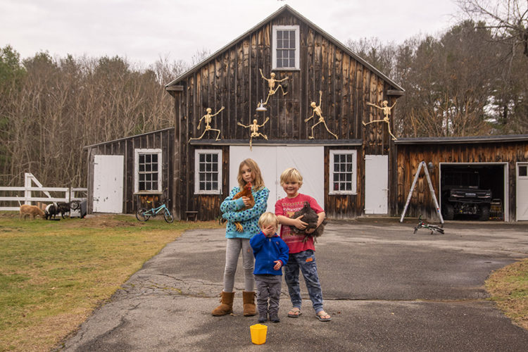 children in front of a barn