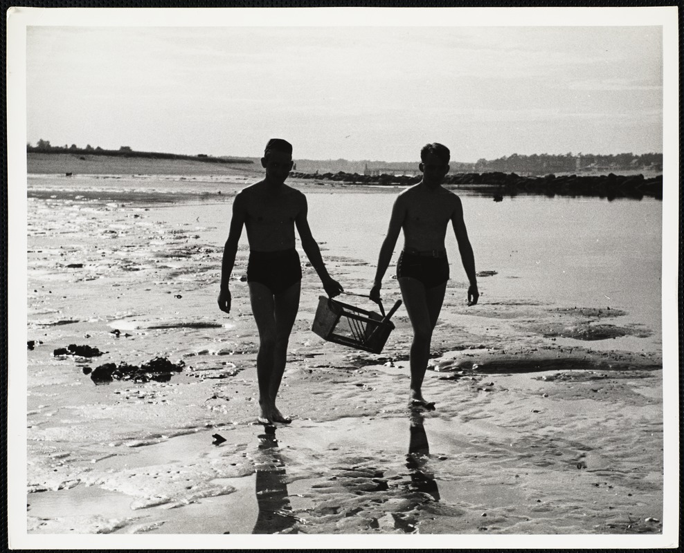 AG Archive: two people walking on the beach