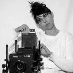 portrait of Donna Garcia with camera