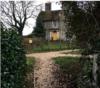 house behind hedge