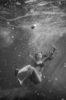 woman sinking in water